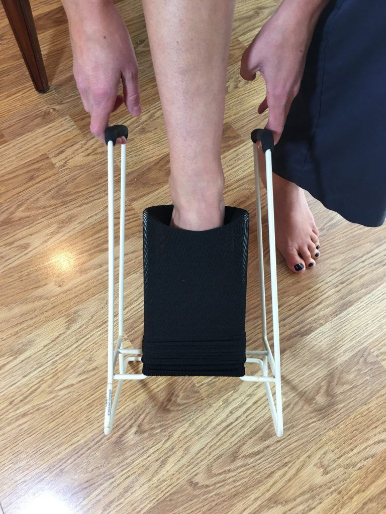 Put on compression socks - Hold tool and put foot into compression sock