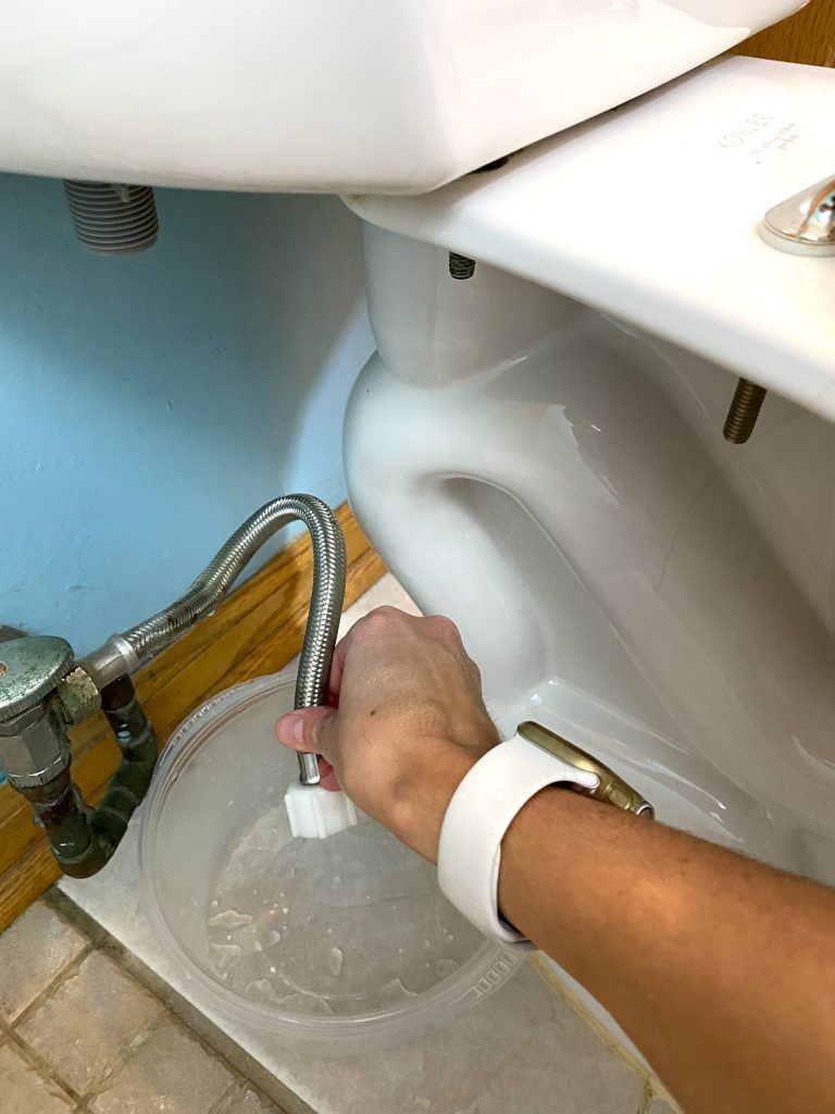 Install Bidet - Hold water line over bucket