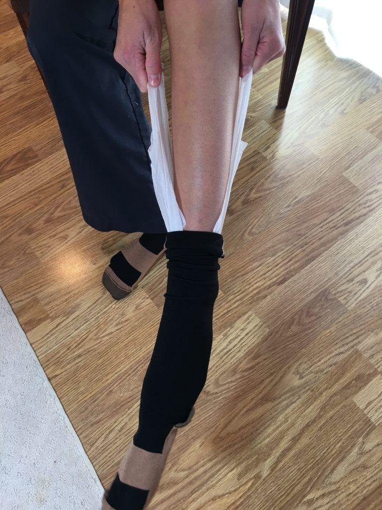 Pull compression sock on using plastic bag