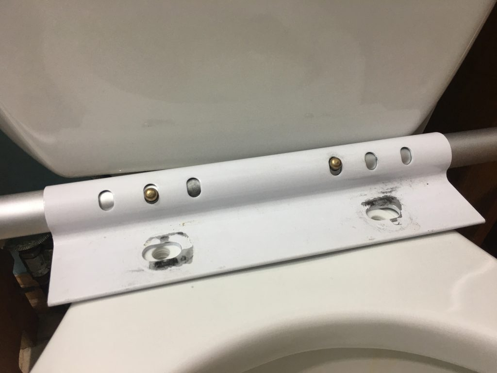 Line up the mounting bracket with toilet seat bolt holes
