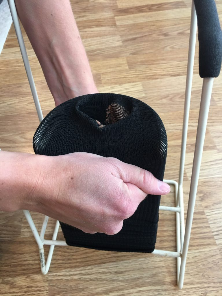 How to put on compression sock - push sock over donning tool with toes down