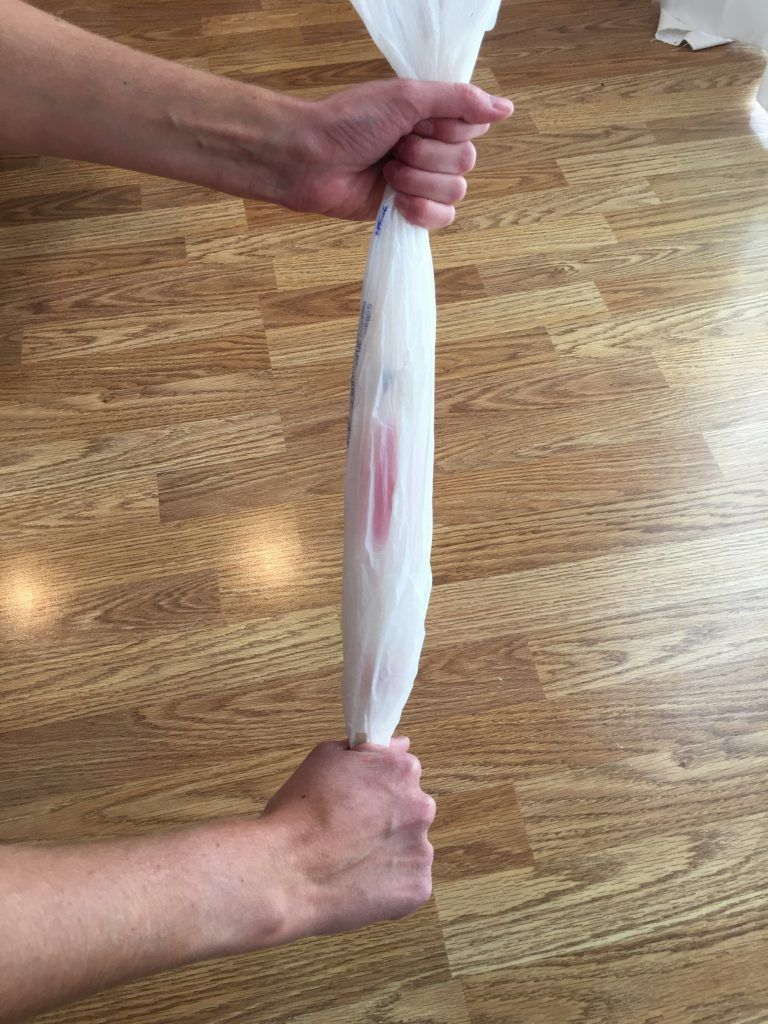 Straighten and tighten plastic bag for putting on compression sock