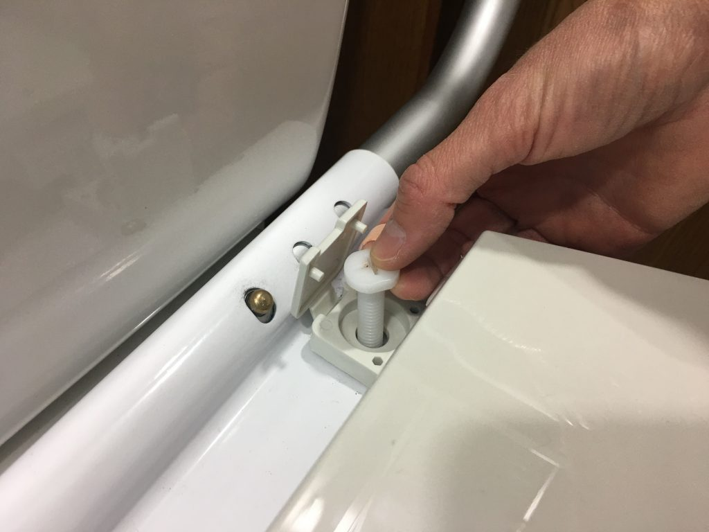Attaching toilet seat with bolt through mounting bracket