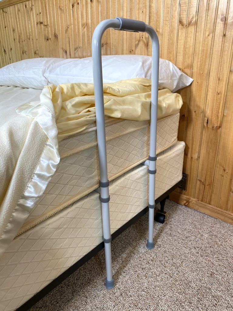Adult bed rail with feet on floor