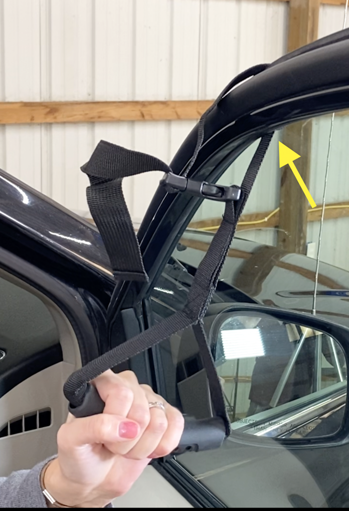 roll up car window to secure window strap