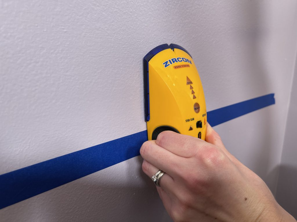 Stud finder scanning for stud in wall - how to install a grab bar