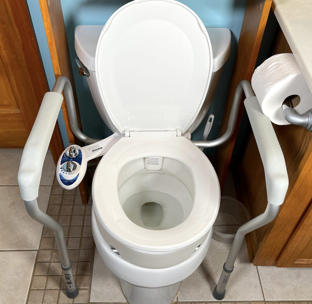 A bidet install with a raised toilet seat