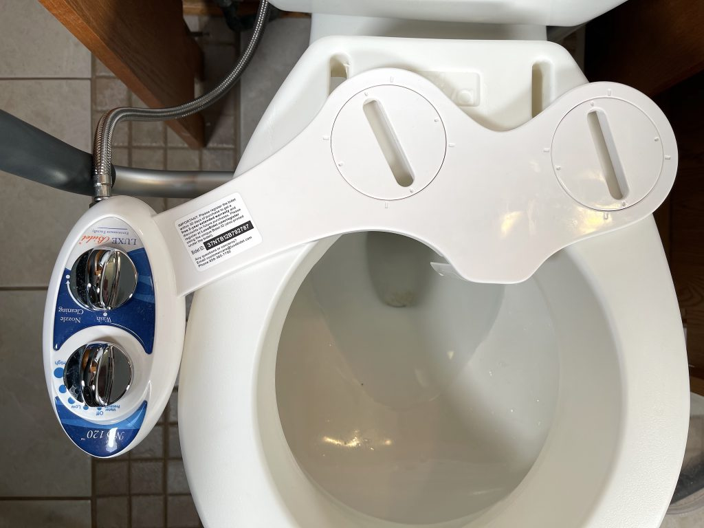 Mounting holes of bidet do not line up with raised toilet seat