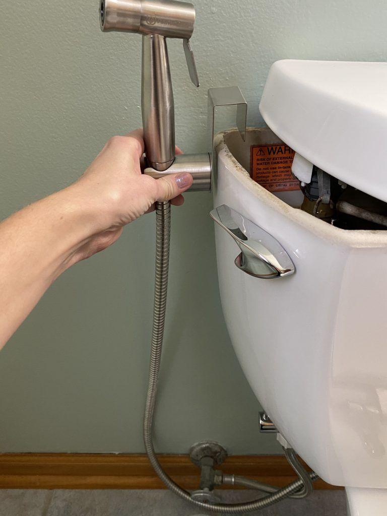 Handheld bidet sprayer attach holder to toilet tank