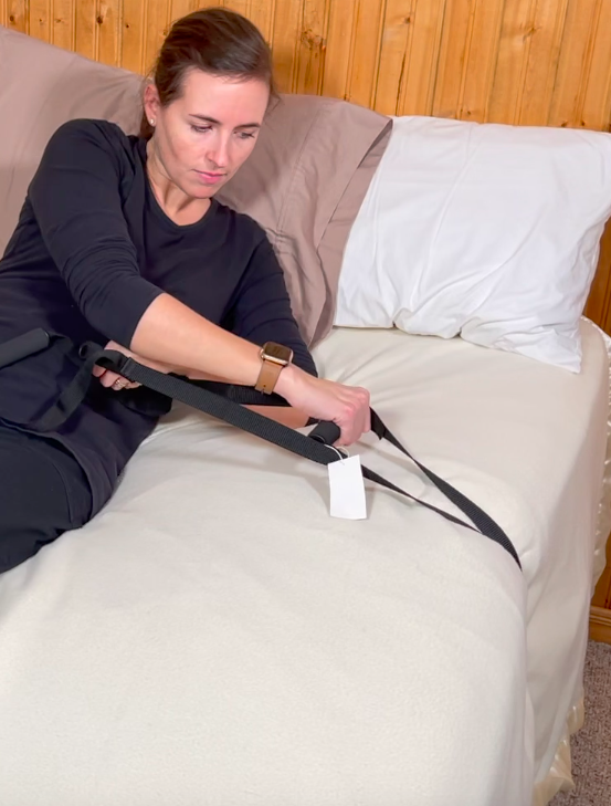 Use bed ladder on the side of the bed for rolling or repositioning - bed mobility aid