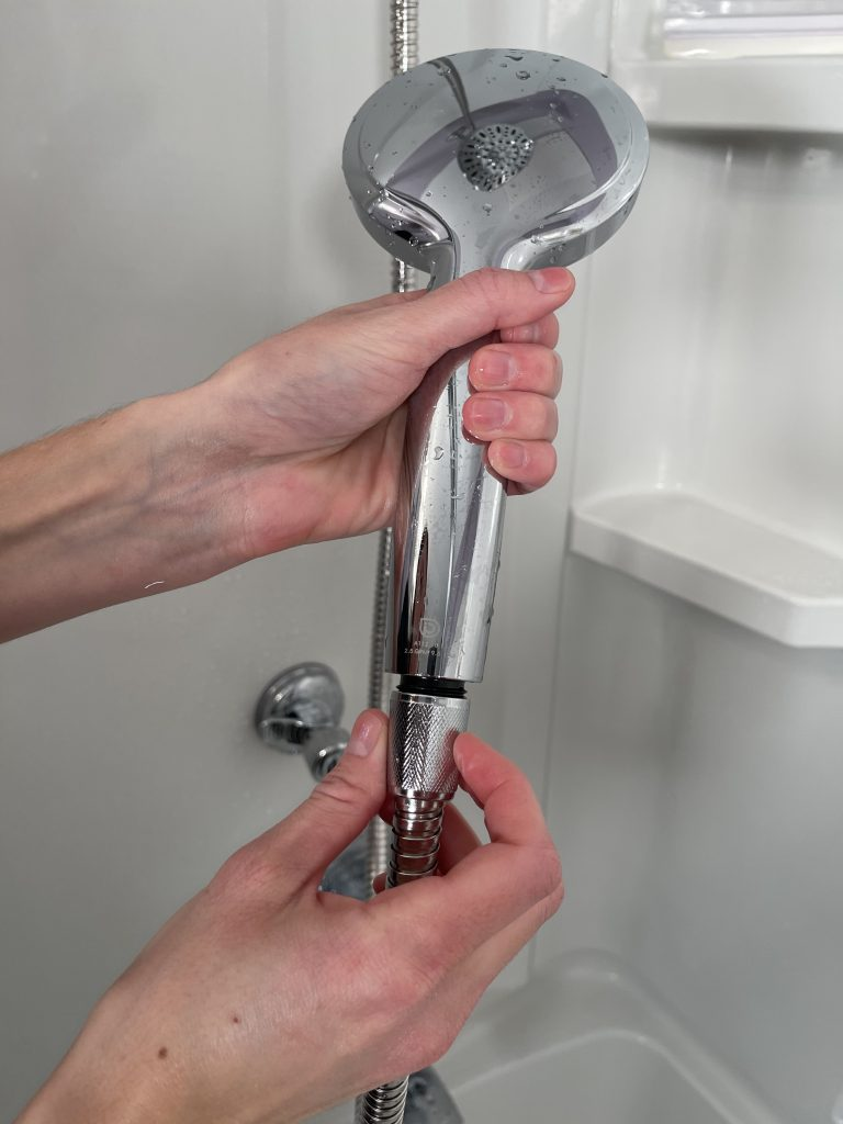 how to attach a hand held shower head holder to the hose